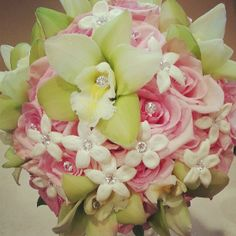Bridal bouquet of green cymbidum orchids, pink roses with diamond pins and stephanotis with diamond pins. Doristhefloristt@aol.com