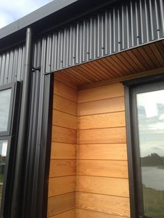 Look at this remarkable hide downspouts - what a very creative concept House Cladding, Exterior Cladding, House Siding, Facade House, Cedar Cladding, Metal Building Homes, Building Exterior, Building A House, Cafe Exterior