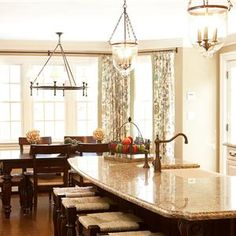 Love the light fixtures...Traditional (Victorian, Colonial) Kitchen by Sheila Jones