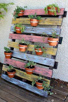DIY Vertical Pot Pallet Planter | 12 Creative Pallet Planter Ideas by DIY Ready at http://diyready.com/pallet-projects-gardening-supplies/