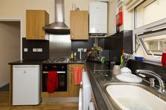 Forest Grove shared house: here's a typical kitchen, which includes a washing machine, fridge freezer and microwave. Forest Grove, Freezer, Washing Machine, Microwave, Kitchen Cabinets, Student, House, Home Decor, Decoration Home