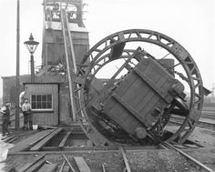 In this instance the wagon contents of coal drops into a pit, thence to a conveyor belt to the top of the coaling tower in the background to be dropped into the tenders of steam locomotives. -- England