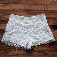 White lace shorts Adorable white lace shorts on mint condition. I wore these about 3 times, they are extremely comfortable and look cute with just about anything!! I purchased these at a sample sale, so there are no tags/fabric content info. However, I'm a size 27 and these fit me great. Side zip on the side. Shorts