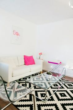 Stylish Pattern rug, white sofa, pink pillows, clear coffee table and chair from IKEA West Sacramento.