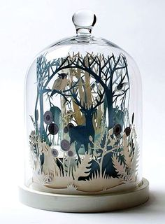 Amazing paper sculpture under a cloche.