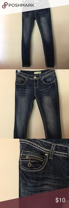 """Almost Famous Premium Skinny size 3 Jeans EUC Beautiful Almost Famous size 3 skinny jeans with nice whiskering and fading in just the right spots!  Dark denim with white stitching.  There is a small zipper pocket above right side pocket. Beautiful.  30.5"""" inseam Almost Famous Premium Jeans Skinny"""