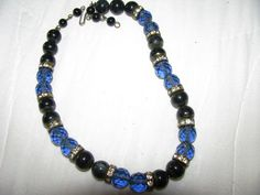 1940s all cut prism blue glass and agate bead with rondelets necklace. etsy shop- VintageAngeline, $55.00 SOLD
