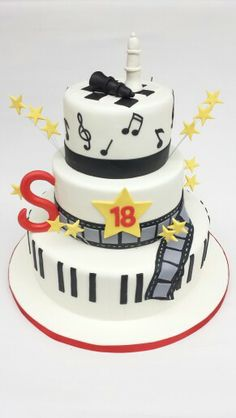 Chess, music notes and movies theme cake