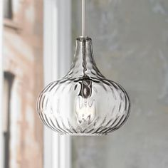 Wearing a brushed nickel finish, this contemporary mini pendant offers a modern aesthetic.