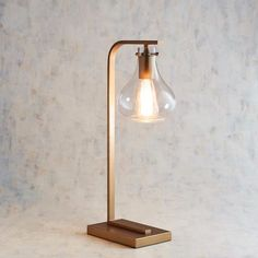 Artfully designed with a clear glass shade, the metal Patty desk lamp provides simple charm with an industrial air. Part of the Magnolia Home Collection by Joanna Gaines. Farmhouse Lamps, Rustic Lamps, Farmhouse Table, Modern Farmhouse, Casas Magnolia, Retro Lampe, Best Desk Lamp, Large Lamps, Unique Lamps