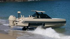 iguana's commuter amphibious yacht drives out of the sea onto the beach