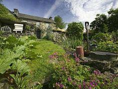 Peter Rabbit's garden at Beatrix Potter's Hill Top Farm, Near Sawrey, Cumbria Lake District, England, UK.