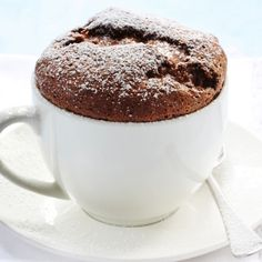 INGREDIENTS: Molds: 3 tbsp unsalted butter at room temperature 3 tbsp granulated sugar Soufflé: 1 ½ cup dutch process cocoa powder, sifted 2 cups water 1 Tahitian vanilla bean, split horizontally a...