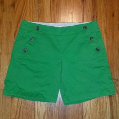 J. Crew Green shorts J crew shorts with button front opening. Side bottoned and rear welt pockets in green size 4. Inseam 7 inches. Front rise 8.5 inches. Waist measures 30 inches. Excellent condition. J. Crew Shorts