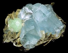 Aquamarine crystals in cluster with light green Fluorites