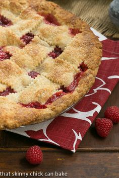Lattice Topped Raspberry Pie | Plus the BEST tender, flaky pie crust made butter and leaf lard | That Skinny Chick Can Bake
