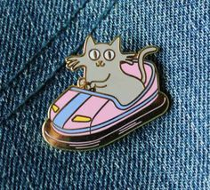 This pin, because why can't cats enjoy bumper cars too?