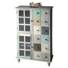Handcrafted mango wood cabinet with two doors and twelve drawers.   Product: CabinetConstruction Material: Mango ...