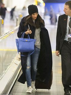 Meghan Markle.. Charter Club Cashmere Crewneck Sweater, Mackage Belted Stretch Wool Envelope Collar Long Coat, Cashmere Slouchy Beanie c/o Zappos, and Adidas Stan Smith Sneakers..