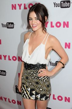 Hollywood celebrity Lucy Hale in  yellow, black and white Aztec printed skirt (glamisfashion.blogspot.in)