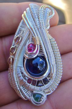 My roommate makes wire-wrapped pendants. Any love for this kind of thing on Reddit? - Imgur
