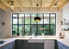 In the kitchen, the couple found barely used appliances instead of new ones to save money. The cabinetry and butcher block counters are from Ikea.