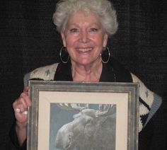 Dinah Christie holds up an original Robert Bateman commissioned for this year's ArtXtreme celebrity art challenge June 2 at the ROC #ontario #art