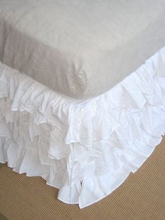 ♥ this is what I wanted to do for paisli's bedskirt, went with tutu instead since this is what her curtains look like, but i now want it for mine!