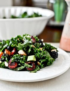 Triple Berry Kale Salad with Fresh Strawberry Vinaigrette. Mmmm. I'm in the mood for this right now!