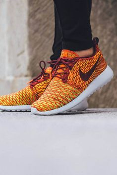 6fba3d2b81a1 Red and crimson colors running throughout the uppers of the latest NIKE  Roshe One Flyknit.