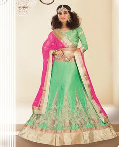 1. Green and pink light festive wear silk and Crepe lengha 2. green raw silk dori work embroidered blouse  3. Crepe lengha with zari thread work and embossed gota borders 4. Comes with a net dupatta with embossed gota border 5. Can be stitched upto size 42