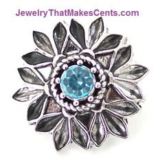 Snap Jewelry Metal Flower w/Blue Rhinestone Center Snap - Only $3 on my website. Browse many base jewelry options at very reasonable prices.  100s of snaps to select from.  www.JewelryThatMakesCents.com PURCHASE $15 OR MORE AND RECEIVE A FREE $2 SNAP. Message me on my fan page for details about your free snap or with any questions you may have. https://www.facebook.com/SnapJewelryOnABudget #snapjewelry