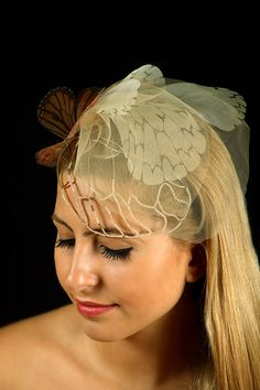 Fluttery Butterflies Head Piece with Organza Butterflies and Nude tone Veil. $185.00, via Etsy.