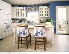 Traditional blue and white kitchen with a bit of beige.  Like the walls and cabinets, change the pattern on valance and chairs