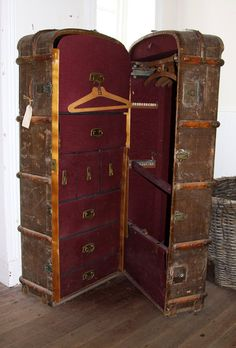 oh my what a lovely wardrobe; I saw one of these at an old antique store the other day, except it was completely metal inside. If I was wealthy, I would have snatched it up in a heartbeat.