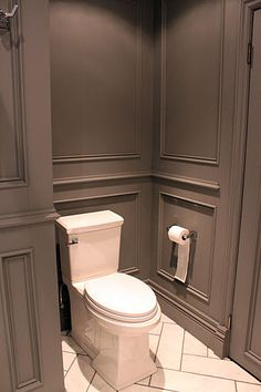 Stunning gray bathroom design features full wall gray wainscoting accented with gray moldings painted Benjamin Moore Asphalt. Stunning gray bathroom design features full wall gray wainscoting accented with gray moldings painted Benjamin Moore Asphalt. Bad Inspiration, Bathroom Inspiration, Bathroom Ideas, Bathroom Gray, Wainscoting Bathroom, Design Bathroom, Bathroom Moulding, Bathroom Pics, Bathroom Things