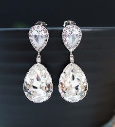 Wedding Jewelry Bridal Earrings Bridesmaid Earrings Dangle Earrings Clear White Swarovski Crystal Tear drops with Cubic Zirconia Ear posts. $27.80, via Etsy.