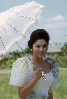 terno queen, Imelda Marcos?  Sleeves on dress are called Imelda Marcos sleeves.