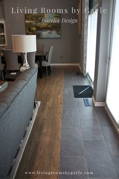 Tile to wood transition in front of glass doors leading to the back yard.