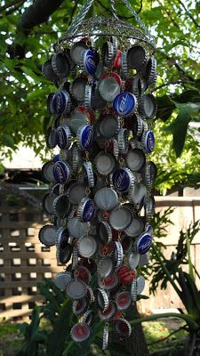 Trina is artsy fartsy: How To Make a Bottle Cap Wind Chime -- love either a steamer or wire basket at the top. this tutorial has details on linking the caps together Bottle Cap Art, Bottle Cap Crafts, Crafts To Make, Diy Crafts, Diy Wind Chimes, Rustic Crafts, Bud Light, Beach Crafts, Camping Crafts