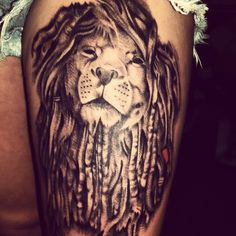 Lion with dreads tattoo
