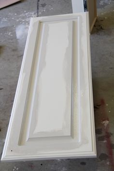 Painting cabinets - good to remember - angle brush for grooves first , 4 inch roller for flat after