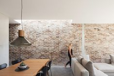 Set within a heritage conservation area, the original semi has been kept in-tact with its roof line restored. A 'breezeway' transition space connects the original house and its new split level contemporary addition, allowing light to filter in to what was otherwise a typical, dark and gloomy south facing house #bricks