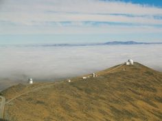 Clouds hanging out below the peaks at Las Campanas Observatory in 2003 #TBT (Photo: Charlie Hull) || Carnegie Institution for Science.