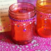 """Moroccan Mason Jars: """"These mason jars were made with Mod Podge and food coloring,"""" Jessie says. """"I then used gold puffy paint to create the Moroccan pattern. Arabian Nights Prom, Arabian Party, Arabian Nights Theme, Arabian Theme, Moroccan Theme Party, Moroccan Decor, Moroccan Wedding, Moroccan Style, Indian Style"""