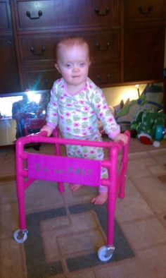 Daddy made a walker out of PVC pipe just for Izy.   2-1/2 year old with down syndrome.  Low muscle tone and cannot walk.