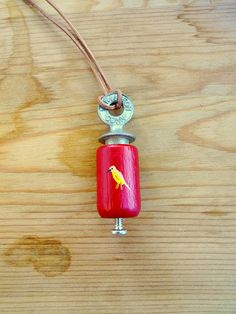 For Hamish- Adorable Hand-Painted Bird call Necklace.... I used to have one of these; wonder what ever happened to it!