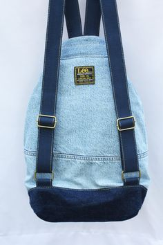 ** the bag in the picture was sold, please contact me to create a new one for you! ask me which colors i have in stock **  this is a durable, large capacity denim backpack, washable and multipurpose- use it for a long shopping day in town, as a school bag, a beach bag, a gym bag, or even a nappy bag. made from a vintage jean jacket in excellent condition. * strong adjustable woven cotton straps * full lining with 1 laptop sleeve (width: 28cm/11) and 1 zipper pocket (width: 20cm/8)  ...