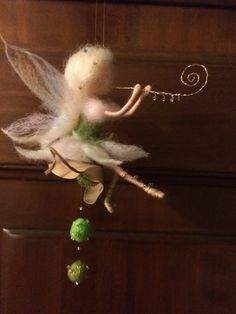 The dress and wings are made of wool is very gentle colored shades. Sandals made of golden thread with beads. The flute made by me from the brass thread. Decor: natural leaf with felting balls. Height of about 15 cm.