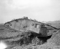 A British tank, probably a Mark III tank, crossing a trench on its way to take part in the Battle of Cambrai, November 1917.